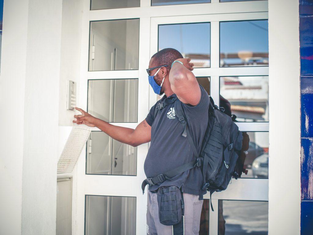 Edu is ringing his client's doorbell.