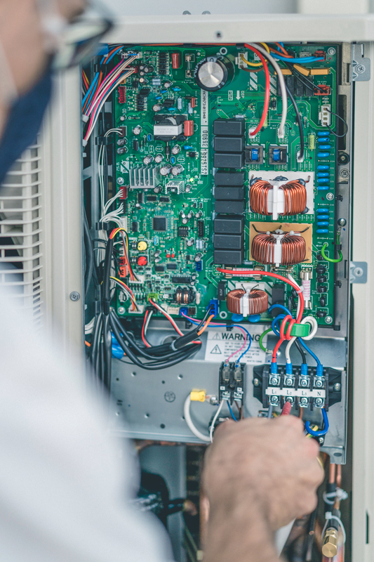 The inner electrical components of an outdoor HVAC unit