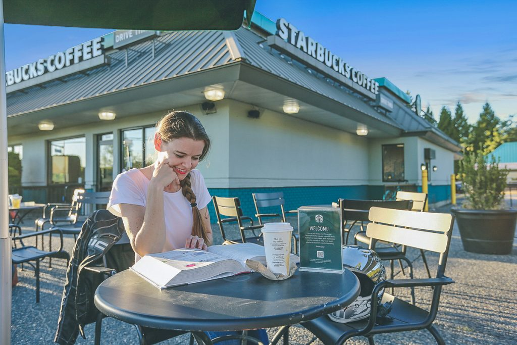 Jessica is reading an HVAC book while enjoying a coffee.
