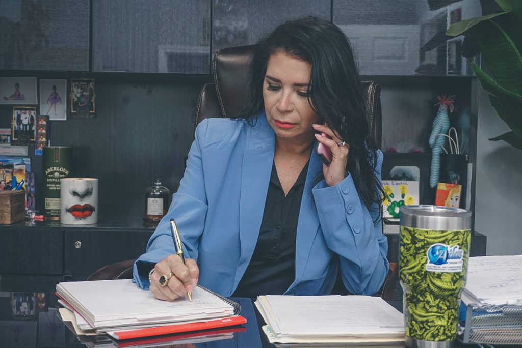Sarah Sagredo Hammond, president of Atlasgrv. She's writing on a notebook.